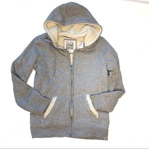 Nollie Sherpa lined zip up jacket with hood.